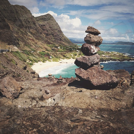 rock formation beside seashore photography  photo