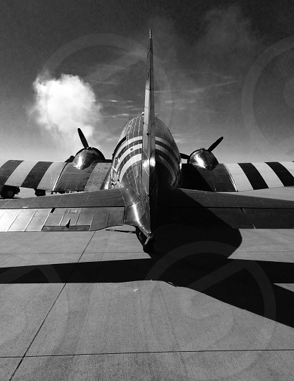 Airplane world war 2 allies invasion stripes fly flightblack and white Skyclouds photo