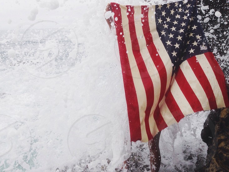 united states of america flag on snowy surface photo