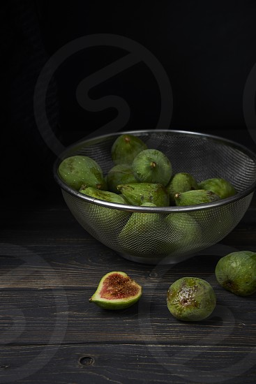 Green figs on a rustic background photo