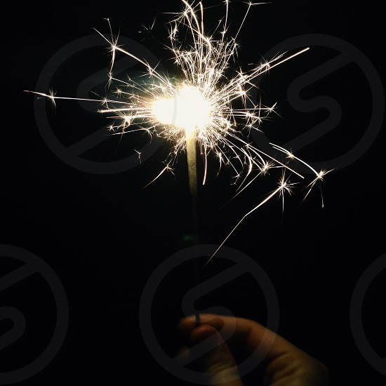 small fire work on hand photo