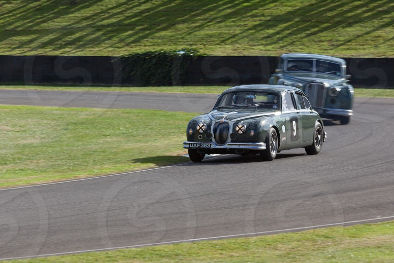 GOODWOOD WEST SUSSEX/UK - SEPTEMBER 14 : Vintage Racing at Goodwood on September 14 2012. Two unidentified people photo
