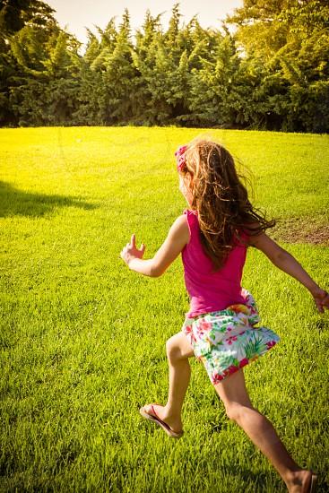 girl running little girl fun sunny  sun outdooroutsideoutdoors summer field freedomcarefree happy motion energy happiness joy colorful daylight photo