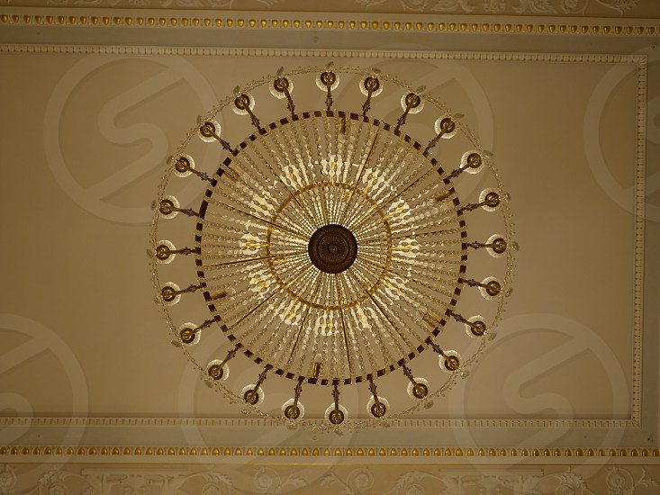 Crystal chandelier hanging from ceiling photo