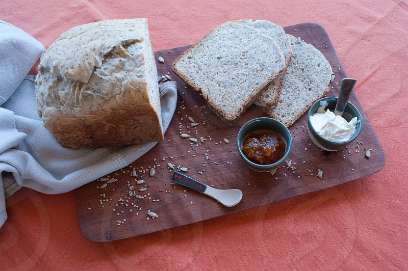 A healthy breakfast with homemade bread spreadable cheese and pumpkin jam. photo