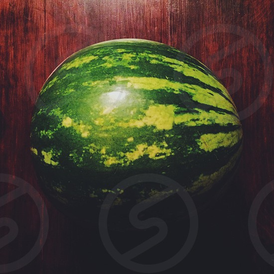 Watermelon on rustic table photo