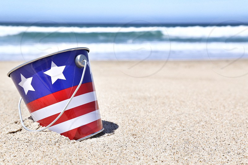 Red White and Blue Bucket at the Beach photo