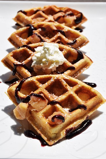waffles with chocolate syrup with cream photo