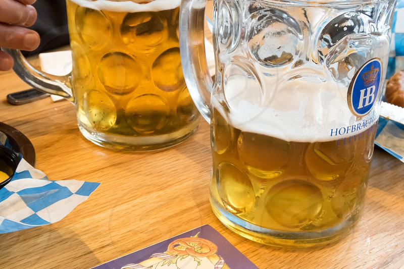 Steins of beer at a German restaurant photo