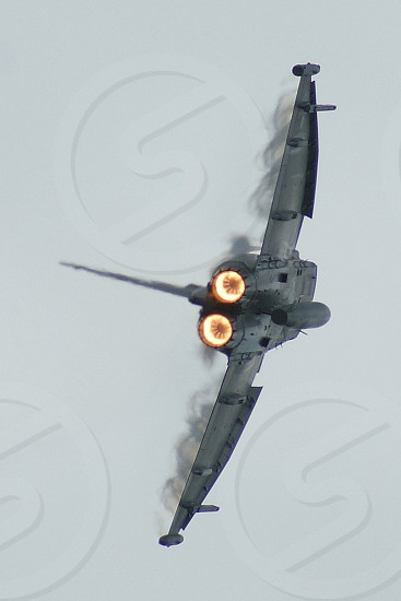 grey military jet flying photo