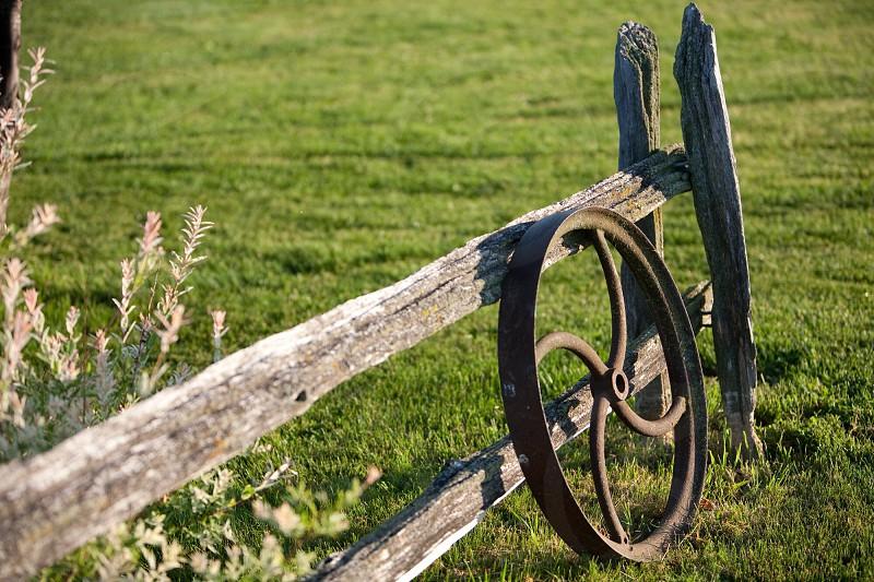 metal wheel on wooden fence photo