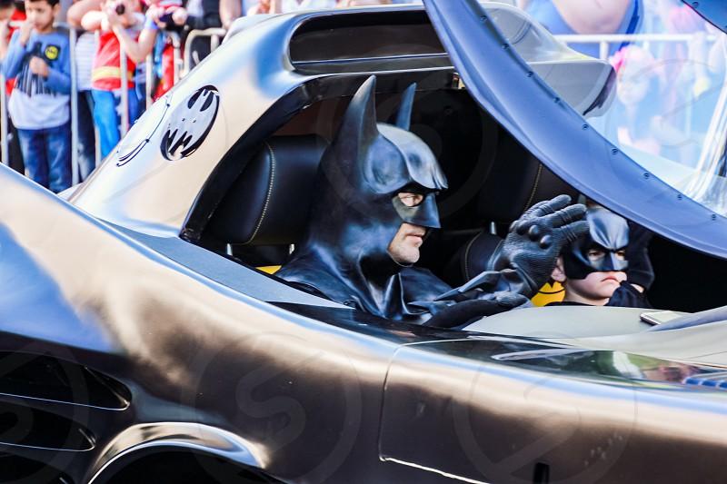 Batman in a batmobile - street parade photo