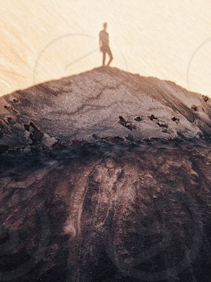 person standing on mountain top photo
