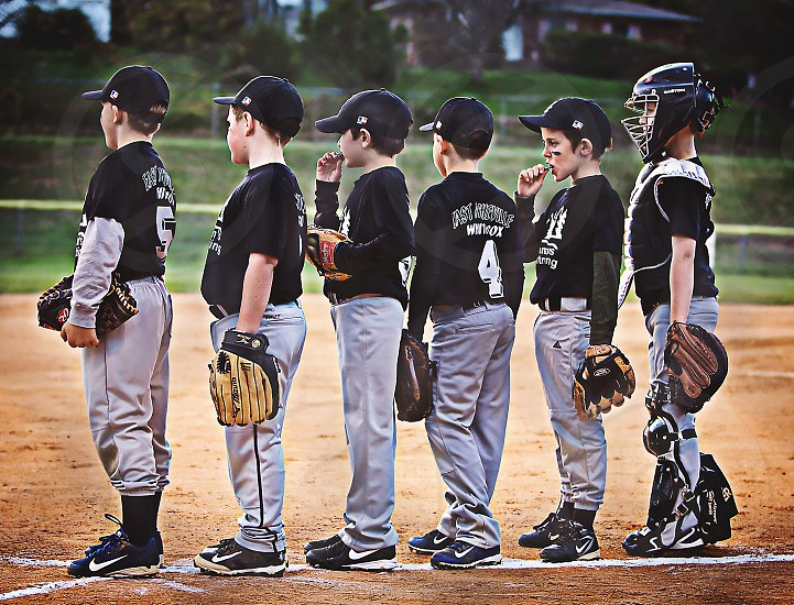 Little league baseball team lined up to thank the other team following a game photo