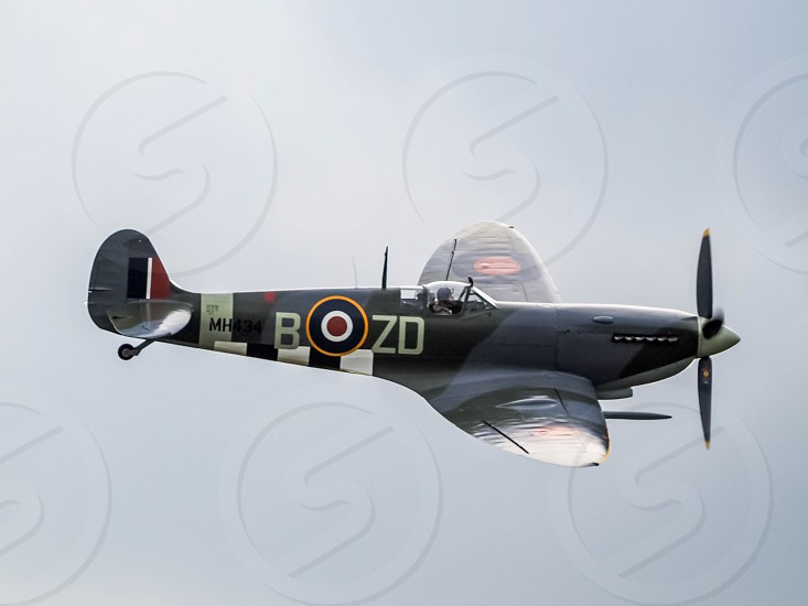 Spitfire MH434 flying over Biggin Hill airfield photo