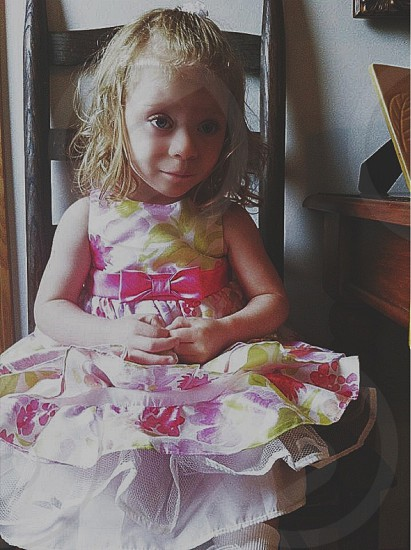 Cute and colorful little girl wearing a beautiful dress..  photo