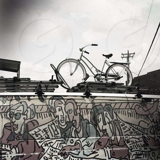 white bicycle on car roof photo