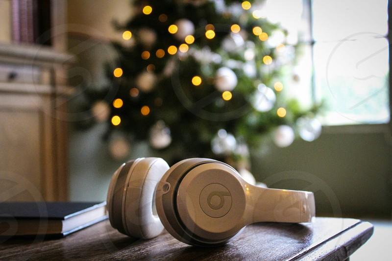 white beats by dr.dre headphones in table near christmas tree photo