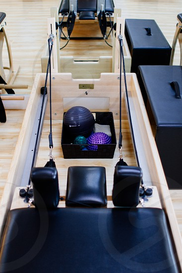 blue and purple stability ball in black storage box photo