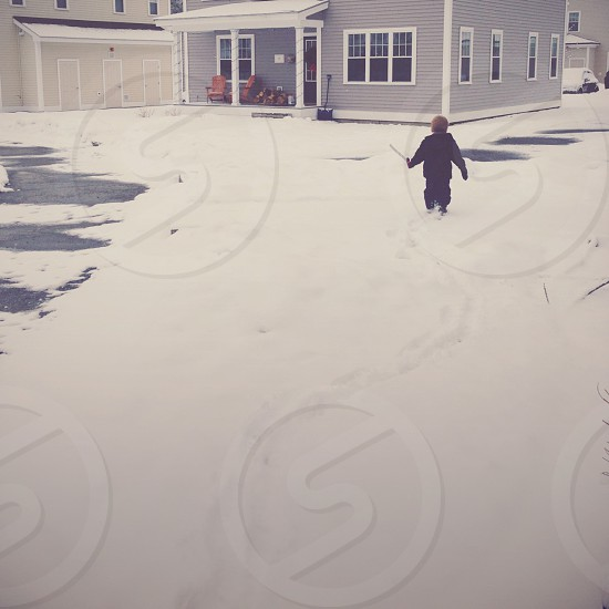 Boy trudging through snow photo