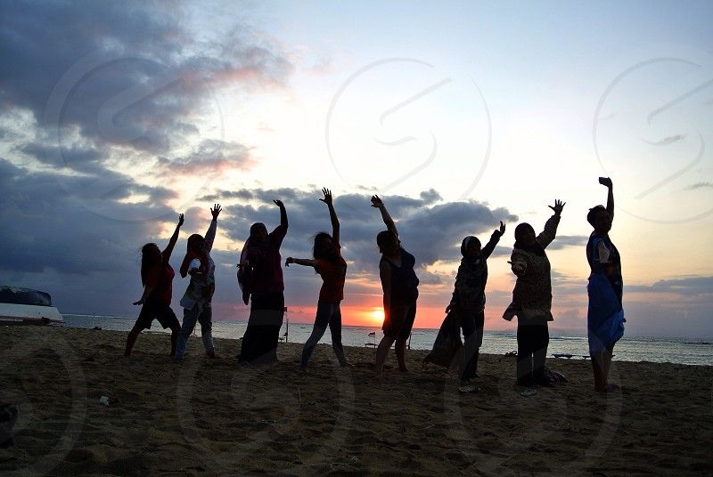 people at the beach during sunrise photo