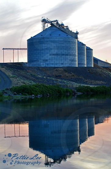 Silo reflection on the river photo