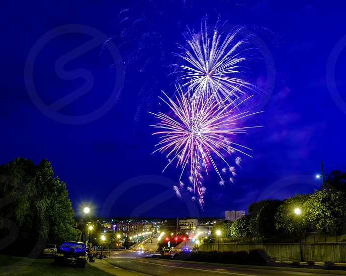 Independence  Day fireworks with city street in the photograph. photo
