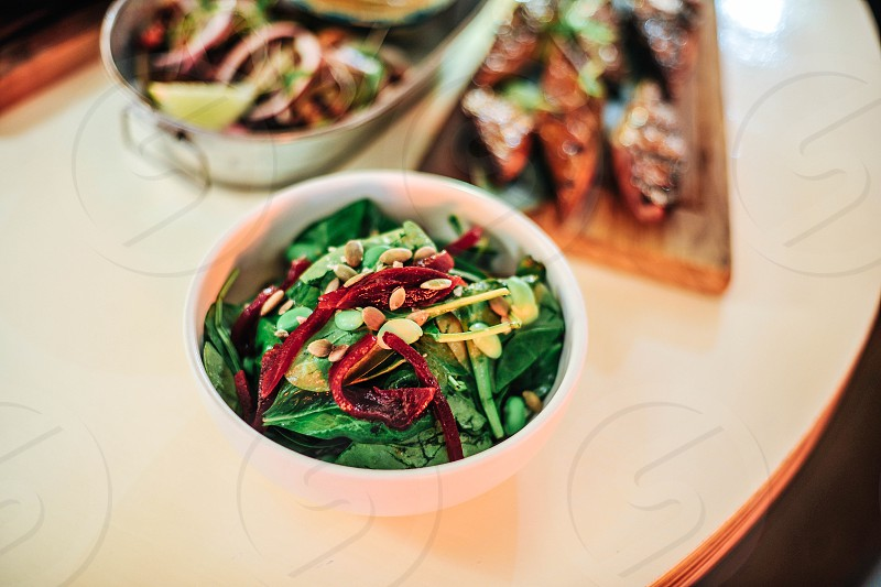 green salad with sliced almonds and sun dried tomatoes photo