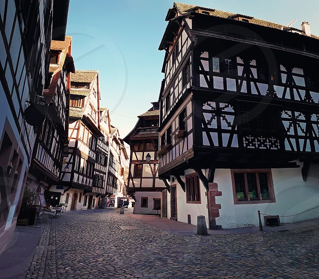 Strasbourg narrow streets of the old city with idyllic half timbered facades of medieval buildings. Beautiful architecture Petit France district Alsace. photo
