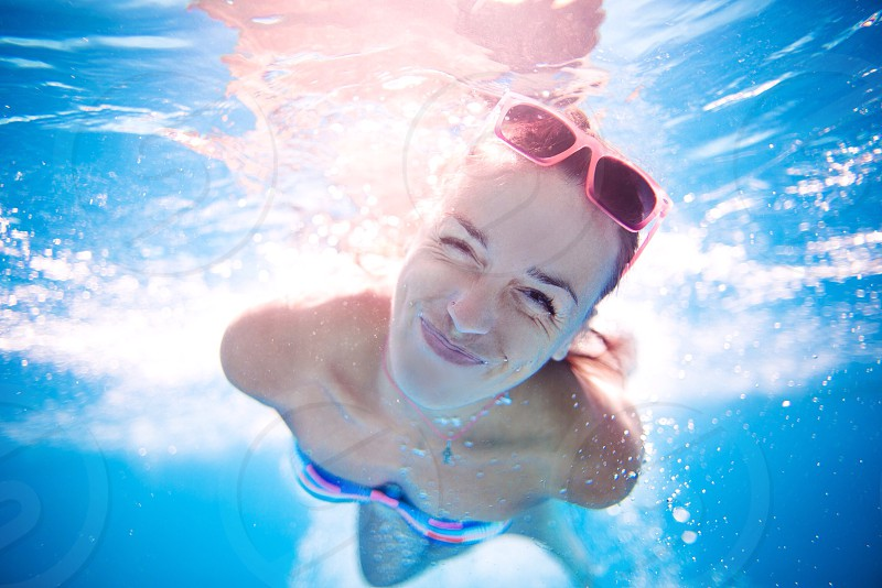 Happy girl underwater joy happy smile water sea swimming-pool cute amazing glasses emotions model  photo