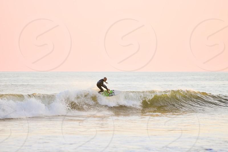 california surfer at sunset photo