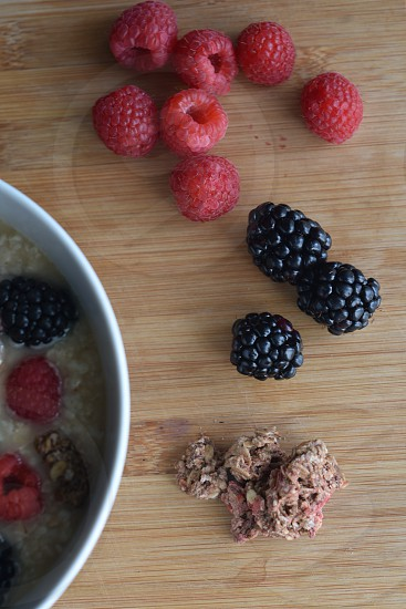 Healthy breakfast mixed berries oatmeal yogurt frozen berry low-fat summer treat ideal for eating after exercise. photo