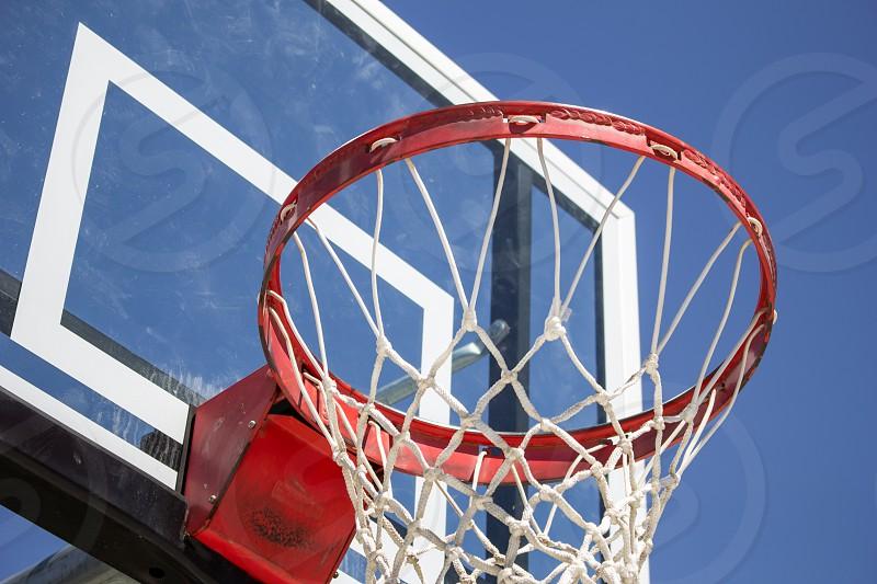 Looking up at a basketball hoop and board photo