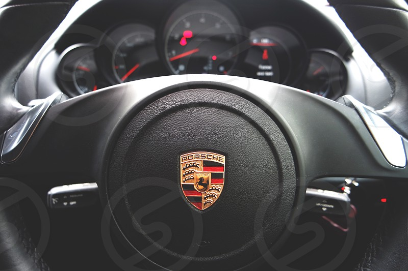 closed up photography of porsche multifunction steering wheel photo