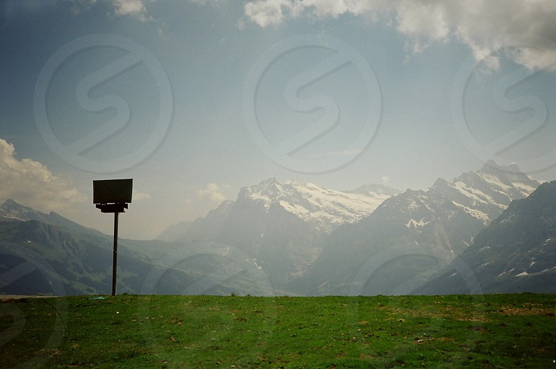 alps sign mountain switzerland grass photo