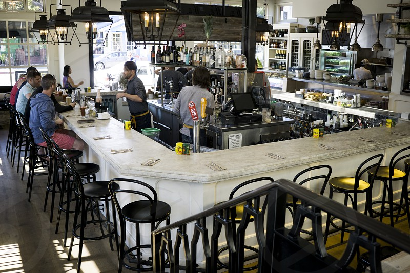 white ceramic counter top and black bar stool photo