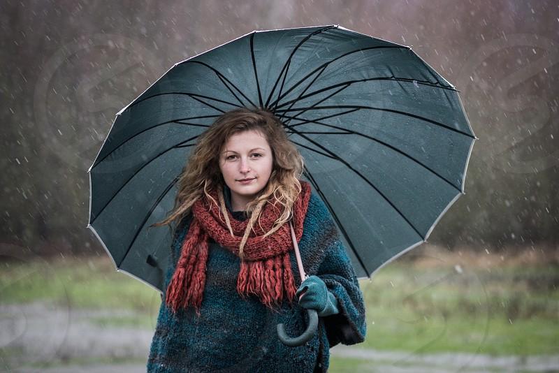 beautiful girl umbrella rain photo