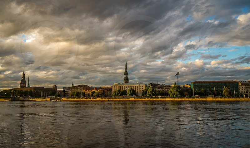 Panorama of Old Riga city at sunset. View from the Daugava river photo