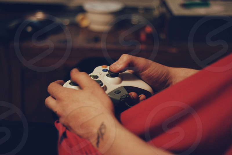 person holding a white game controller photo