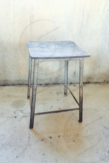 metal stool in a room photo