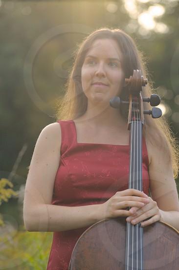 smiling woman holding cello photo