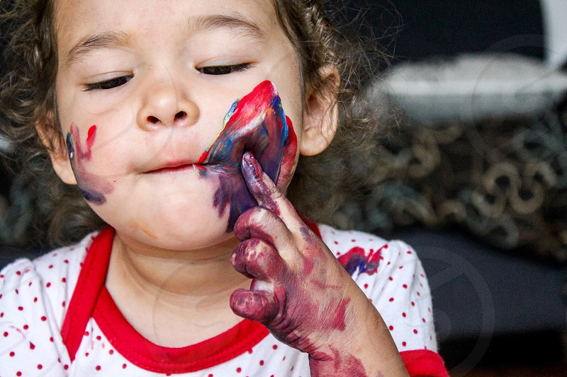 Toddler painting fun cuteness painting  photo