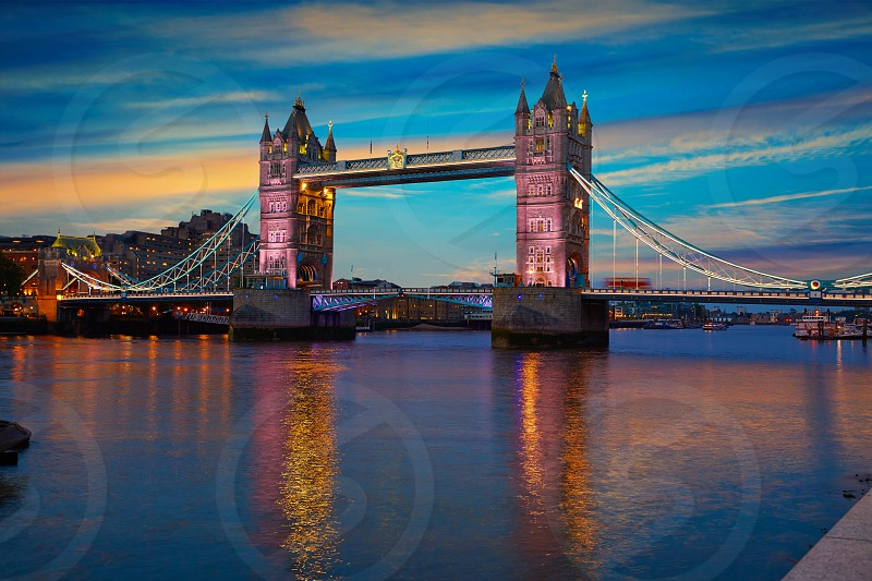 London Tower Bridge sunset on Thames river in England photo