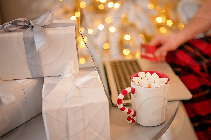 gift festively wrapped with love with a ribbon for the holiday. Merry Christmas and Happy New Year. St. Valentine's Day. Anniversary and birthday. photo