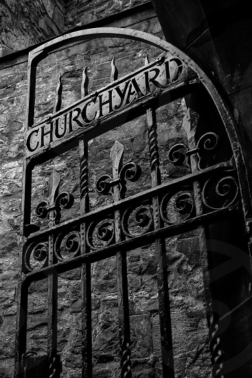The ominous gate welcoming people to the ancient Greyfriar's graveyard and church in Edinburgh Scotland. photo