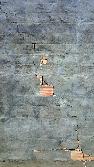 A broken concrete facade over a brick wall. Taken in Saskatoon Saskatchewan Canada. photo