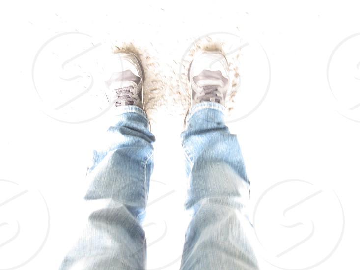 man with white shoes standing on sand photo
