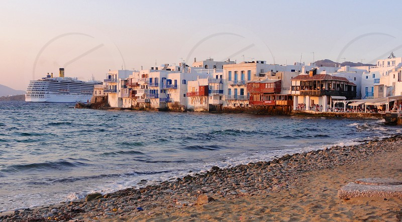 View of Little Venice and cruise ship from Mykonos Town beach photo