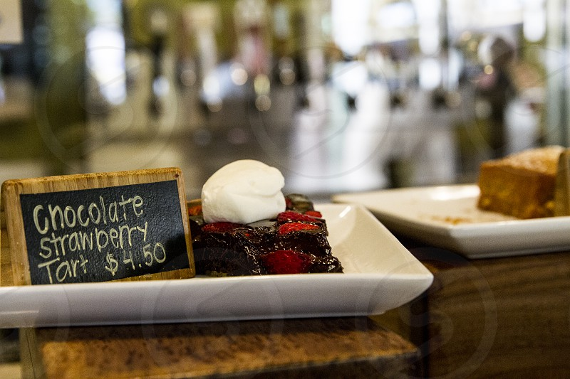 chocolate strawberry tart on a white ceramic rectangular plate photo