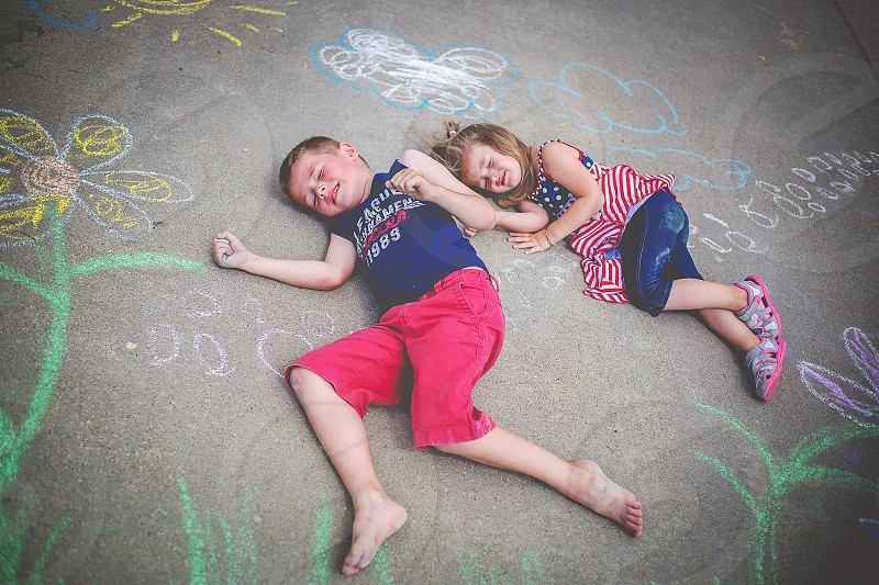 Kid on the 4th of july chalk kids fun summer drawings photo